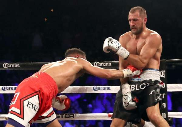 Andre Ward (L) and Sergey Kovalev battle during