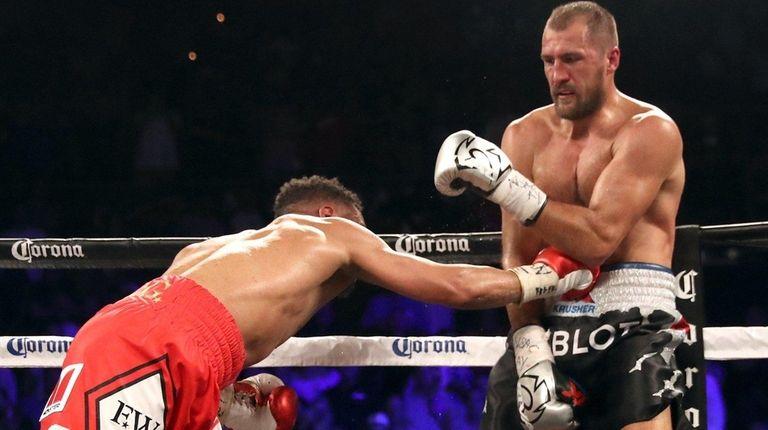 Andre Ward (L) and Sergey Kovalev battle during
