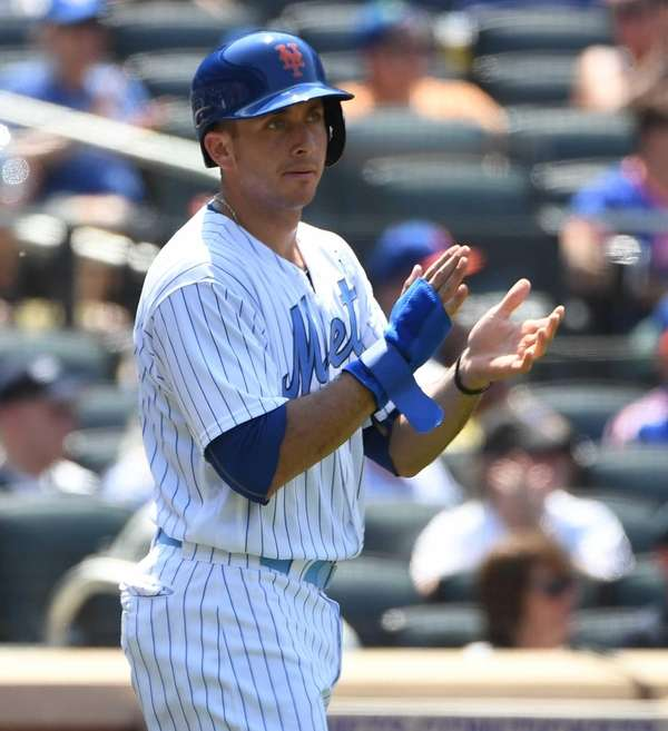 Mets third baseman T.J. Rivera reacts after he