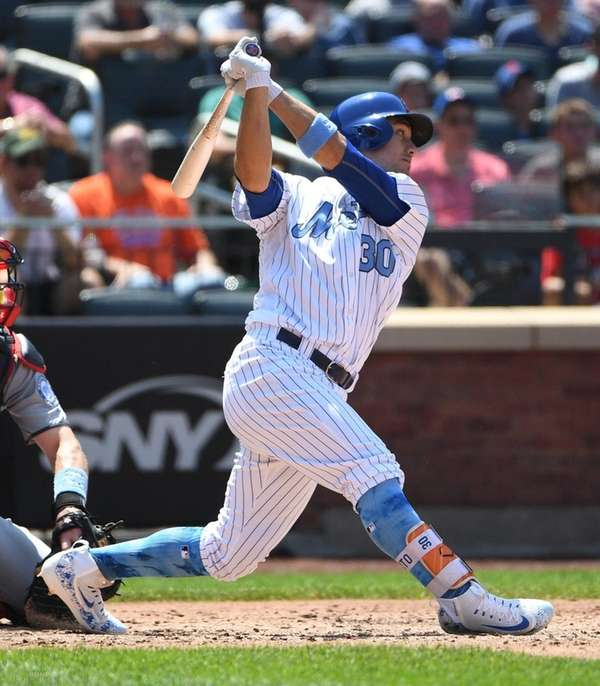 Mets' Michael Conforto hits an RBI single against