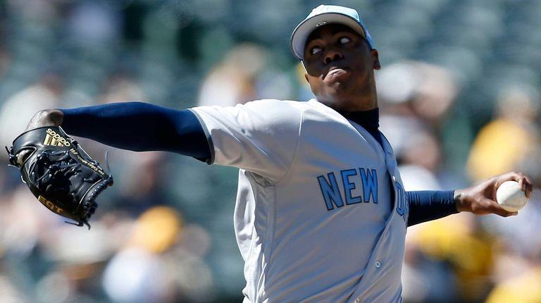 New York Yankees pitcher Aroldis Chapman (54) throws