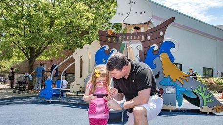 Daniel Eggermann with his daughter Juliette at Children's