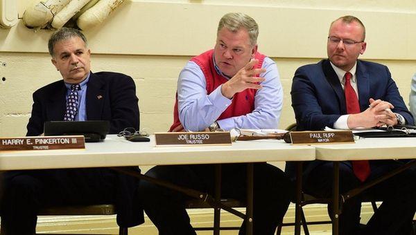 Mayor Paul Rupp, flanked by trustees Joe Russo