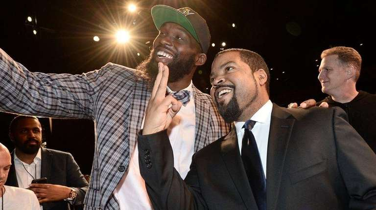 Ice Cube, right, and Reggie Evans at the