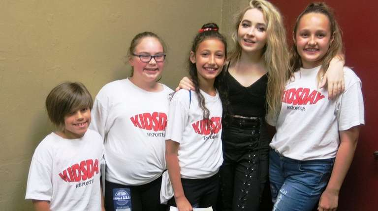 Actress and singer Sabrina Carpenter, second from right,