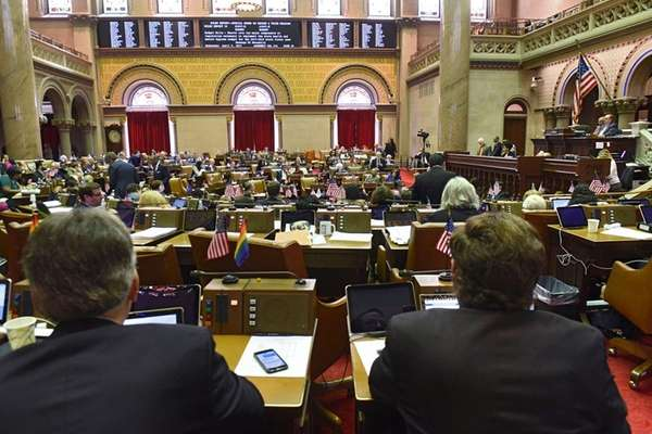 Members of the New York State Assembly vote