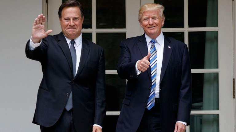President Donald Trump stands with Panamanian President Juan