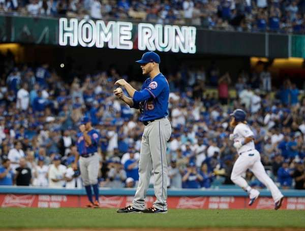 Mets starting pitcher Zack Wheeler stands near the