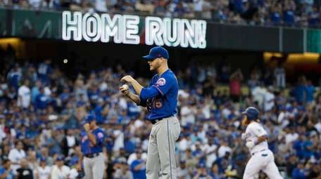 Mets starting pitcher Zack Wheeler stands near the