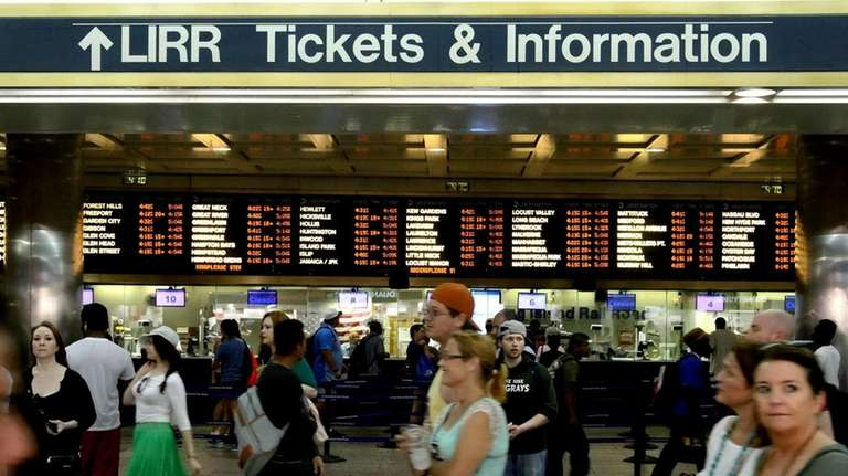 An LIRR train arrives at Penn Station. The