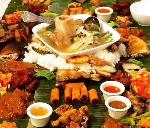 The Kamayan feast, eaten with the hands, is