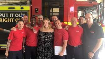 Pop star Adele meets firefighters at Chelsea Fire