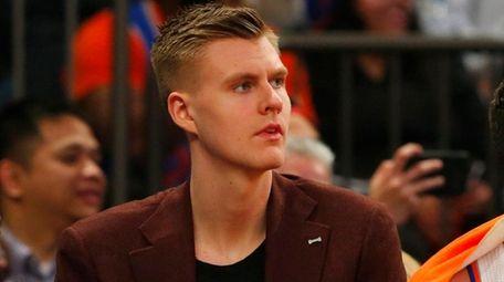 Knicks forward Kristaps Porzingislooks on from the bench