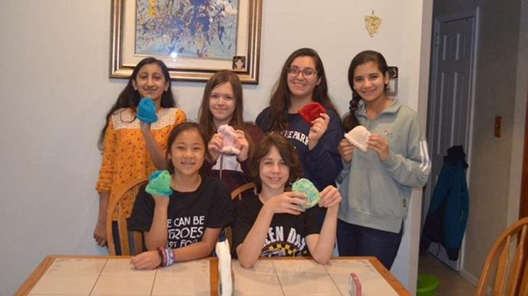 Girl Scout Troop 1273 includes, clockwise from top
