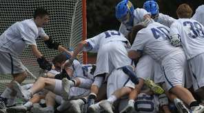 Kellenberg teammates celebrate after their 11-9 win over