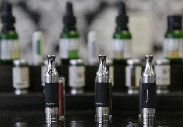 Electronic cigarettes and accessories displayed at a store