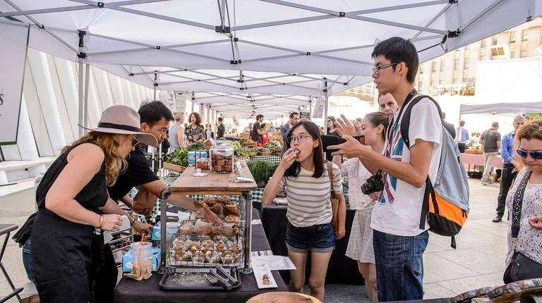 Visitors enjoy samples in the Greenmarket at the