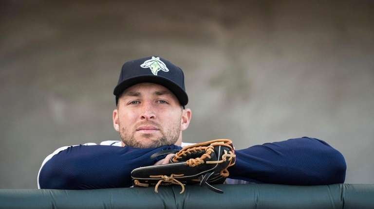 Columbia Fireflies outfielder Tim Tebow looks out from