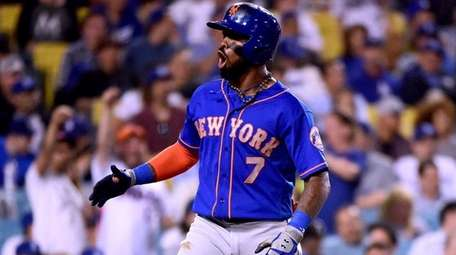 Jose Reyesof the Mets reacts to his two-run