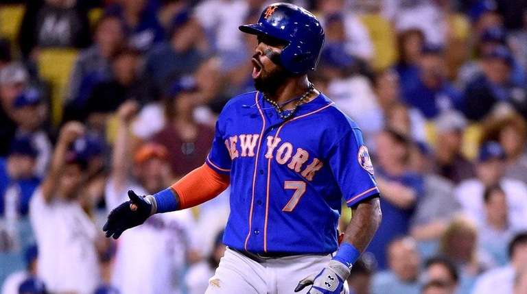 Jose Reyes of the Mets reacts to his two-run