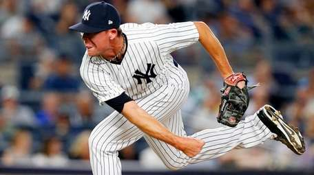 Tyler Clippard of the Yankees pitches against the Angels at