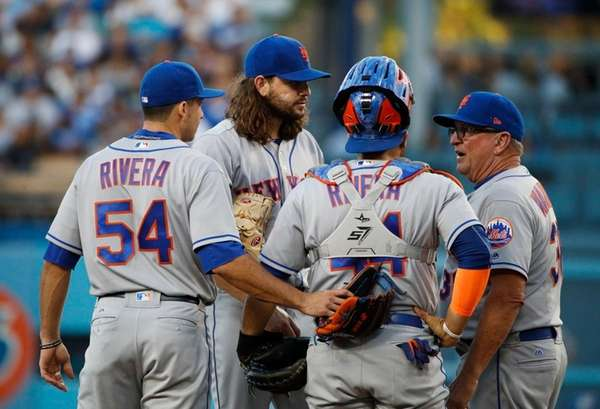Mets pitcher Robert Gsellman listens to pitching coach
