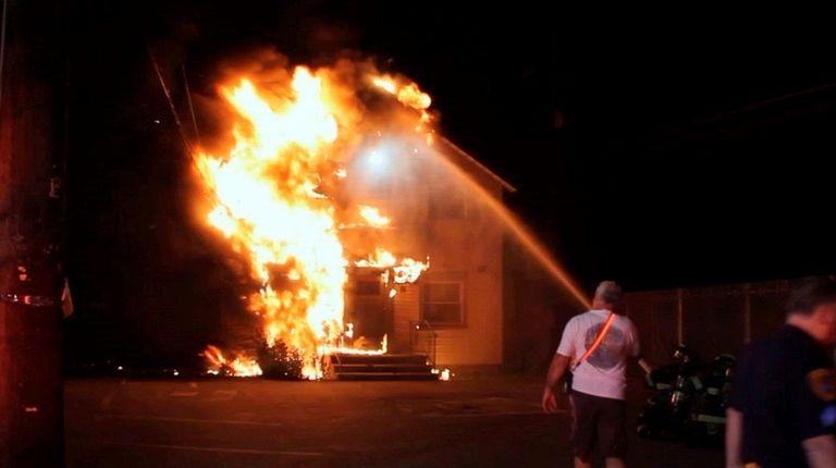 Firefighters battle a blaze in an unoccupied office