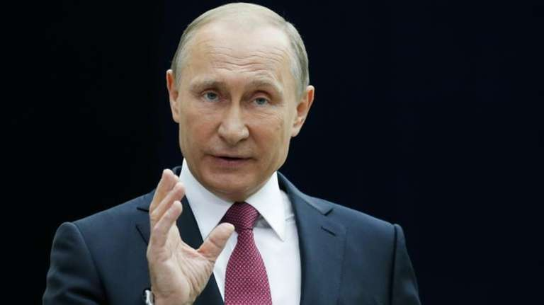 Russian President Vladimir Putin gestures while speaking to