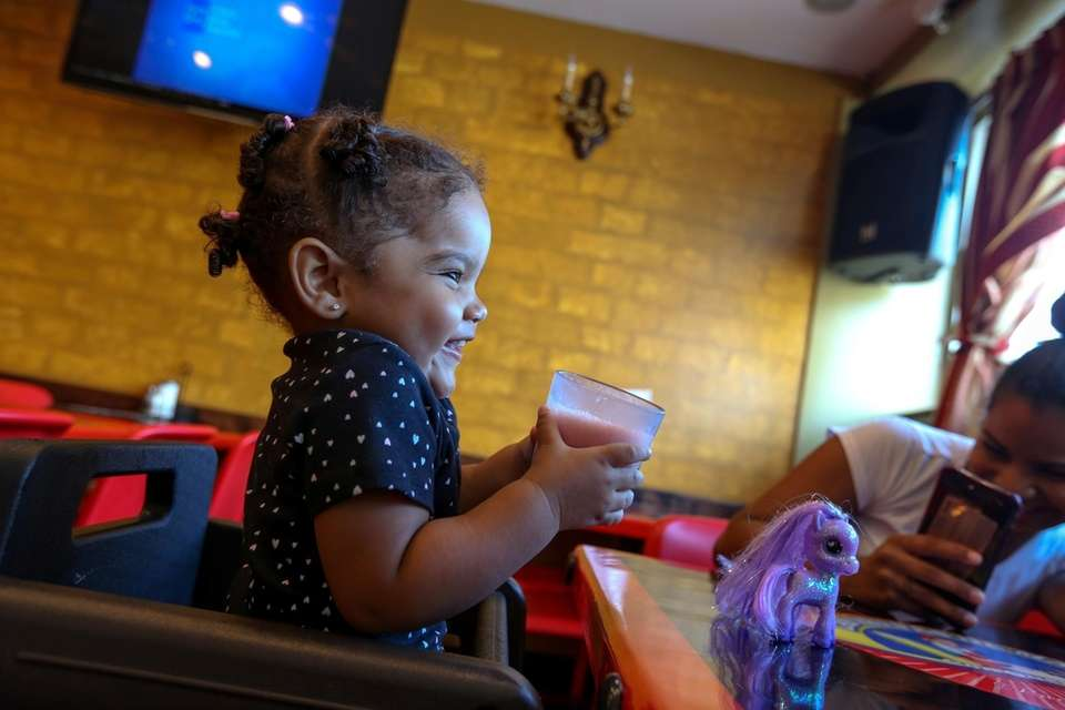 Nashley Hernandez, 1, drinks a cup of passion