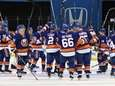 New York Islanders players salute the fans after