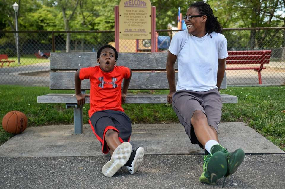 Samantha Corbitt, right, of Roosevelt, shows Ja'Mere Johnson,