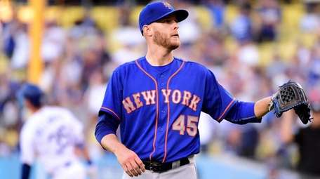 Zack Wheeler of the Mets reacts during the