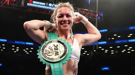 Heather Hardy celebrates her decision win against Edina