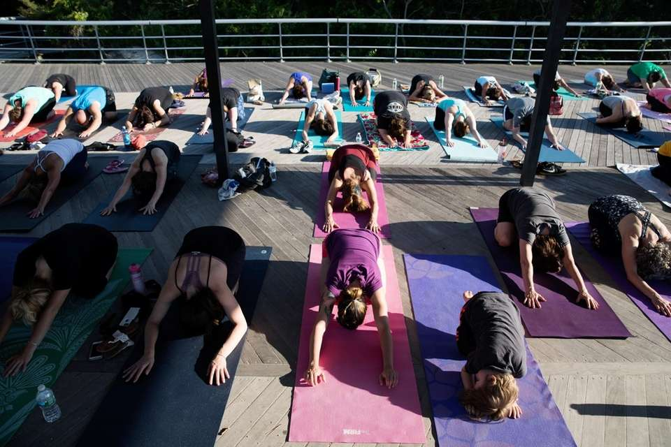 Members of the community attend a donation-based yoga
