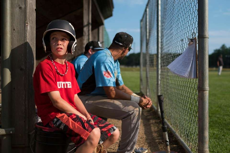 Sag Harbor Whalers batboy Dominick Mancino, 11, watches
