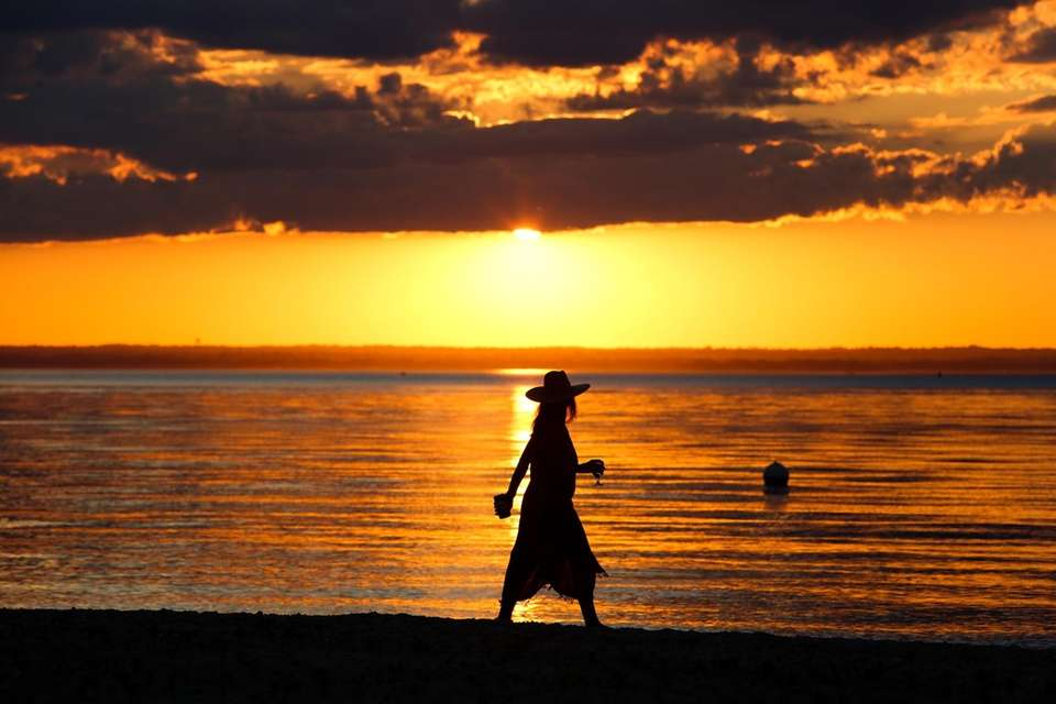 Marjorie Marshall of Bayville walks along Soundside Beach