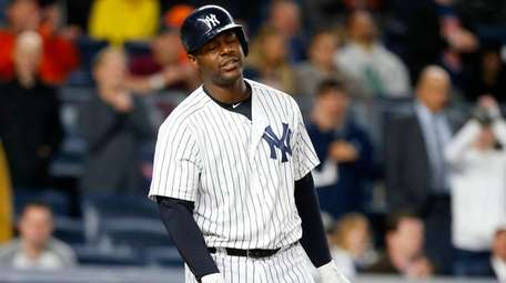 Chris Carter of the Yankees strikes out against