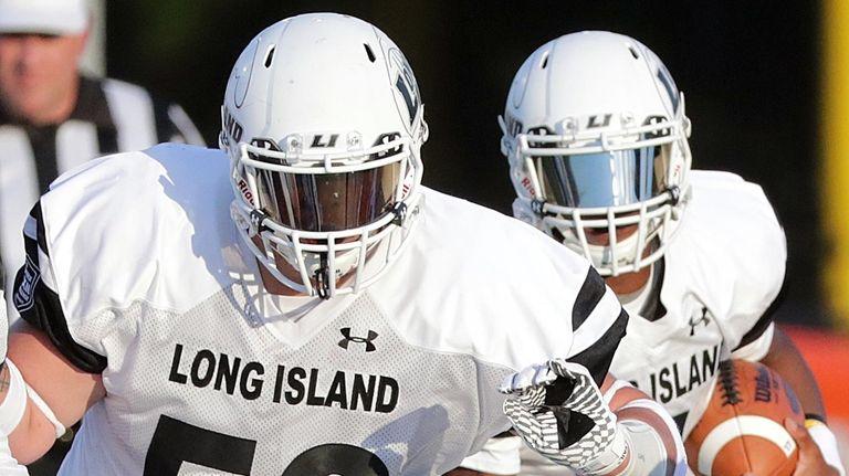 Long Island quarterback Rashad Tucker follows the block