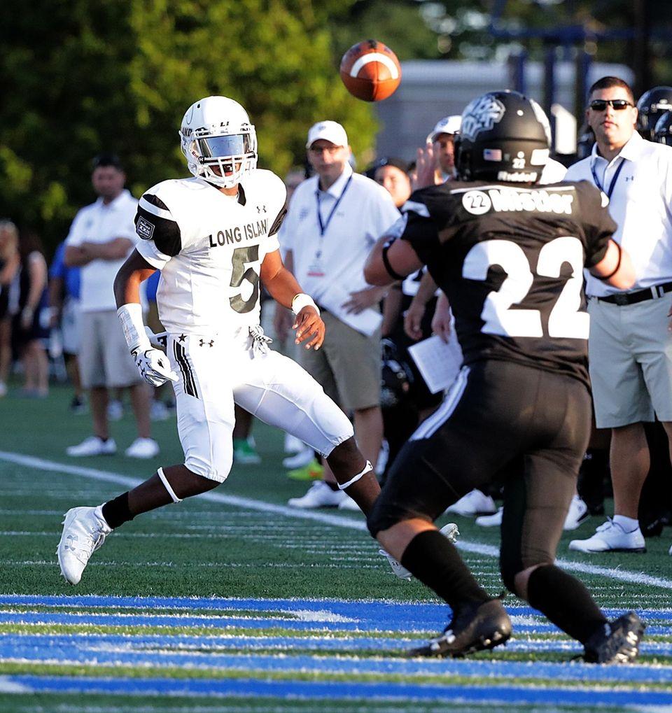 Long Island quarterback Rashad Tucker watches his pass