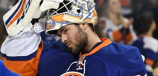 Islanders goalie J-F Berube looks on against the