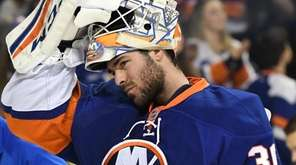 Islanders goalie J-F Berube looks on against the