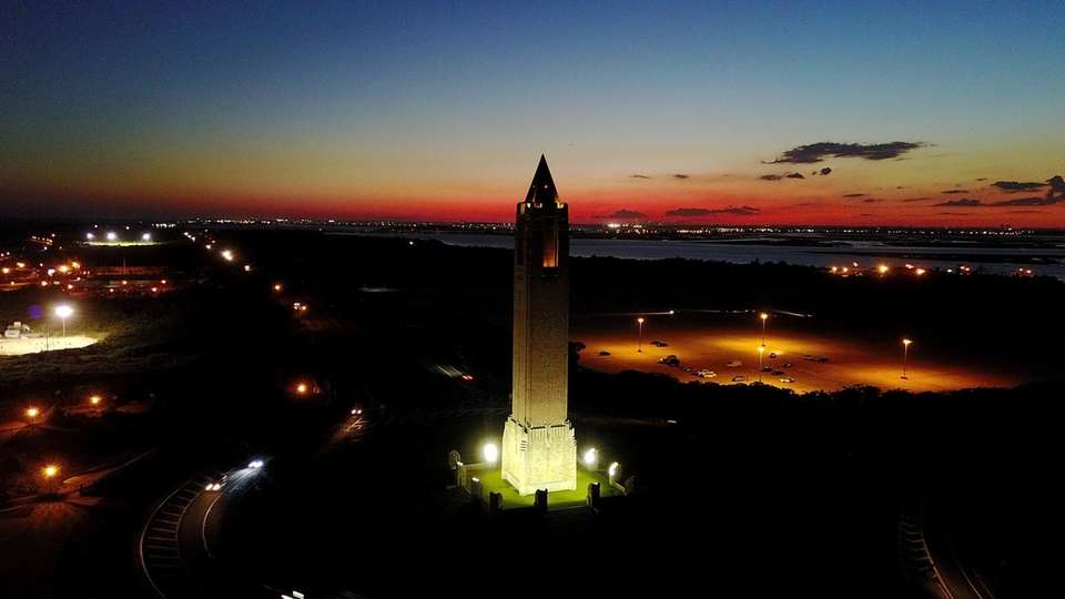 The sun sets behind the Jones Beach tower