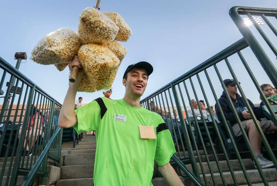 Popcorn vendor Matthew Scagluso, of Patchogue, makes the