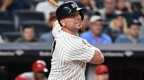 Yankees first baseman Matt Holliday follows through on