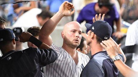 Yankees first baseman Matt Holliday is greeted in