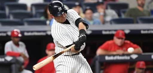 Yankees catcher Austin Romine swings against the Angels at