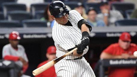 Yankees catcher Austin Romine swings against the Angelsat