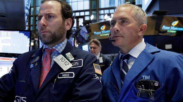 Specialist Michael Pistillo, left, and trader Timothy Nick