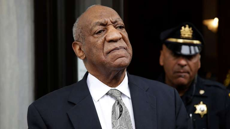 Bill Cosby exits the Montgomery County Courthouse in