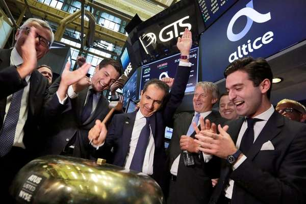 Altice founder Patrick Drahi rings the bell to